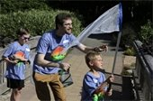 Adult Volunteer and 2 kids collecting butterflies