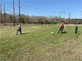 Kids kicking soccer ball