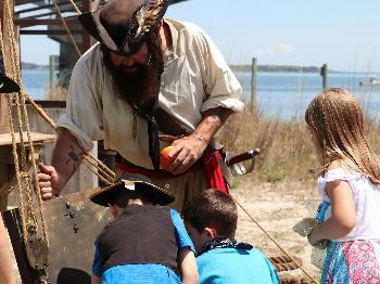 Ye are invited to travel back to the Golden Age of Piracy as Riverwalk Landing and the Watermen's Mu