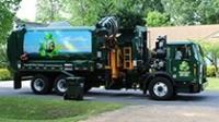 This is an image of a TFC Recycling Truck