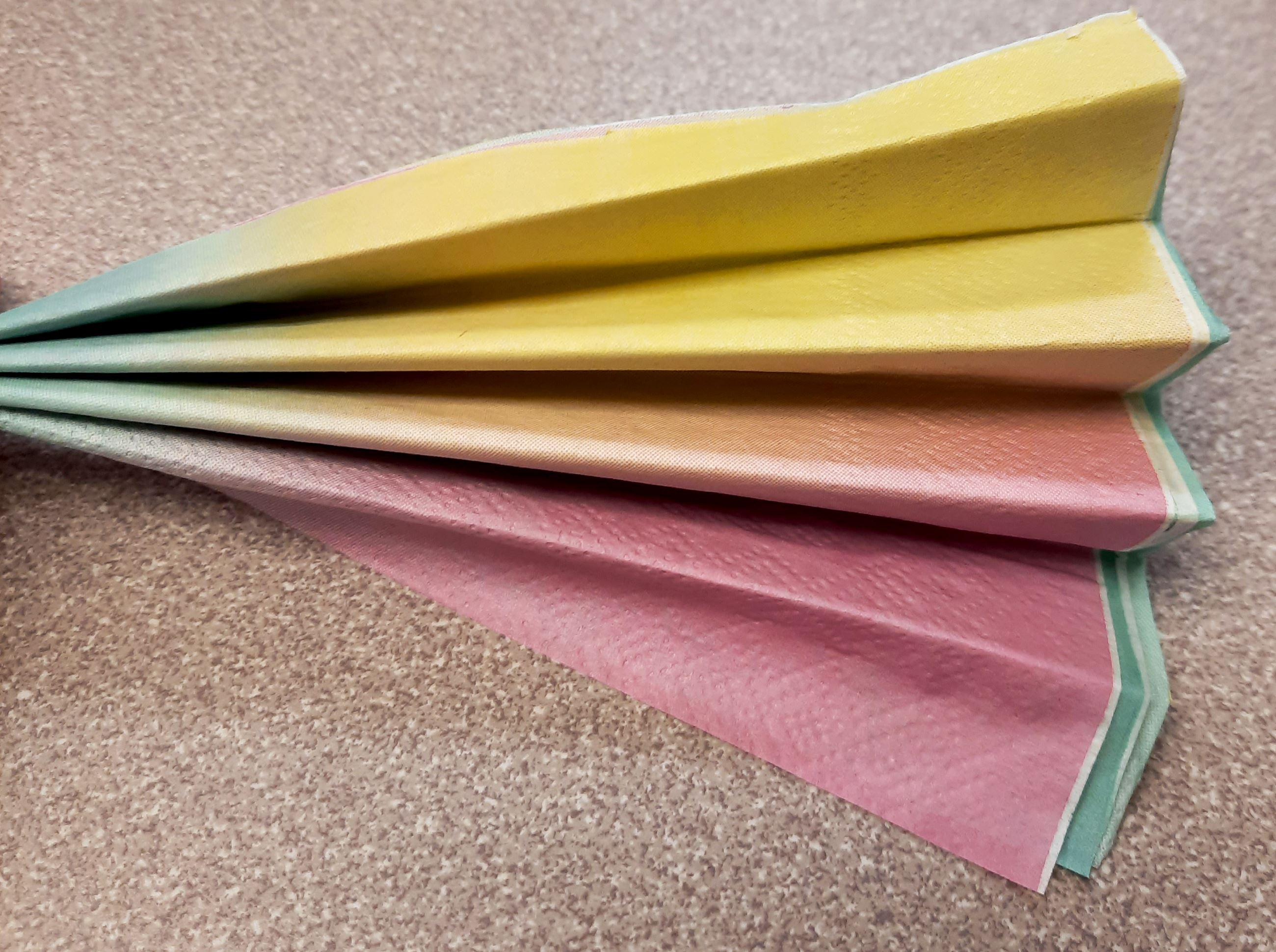 Fold the napkins into an accordion shape.